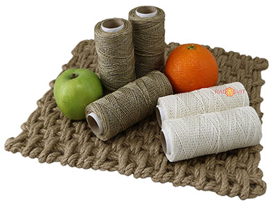 Polished linen twine with apples and oranges on the carpet